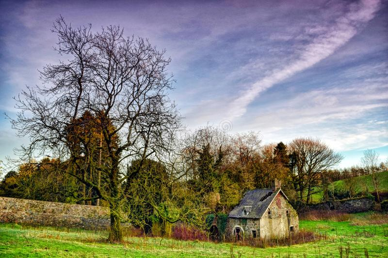 The ruined building in a beautiful surroundings. Very colourful. Dereliction. Beautiful view of amazing nature stock image