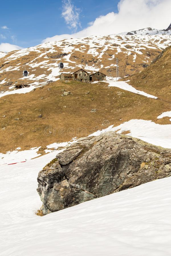Ruined Chalets on a snow-covered scene. Gressoney, Italy royalty free stock image