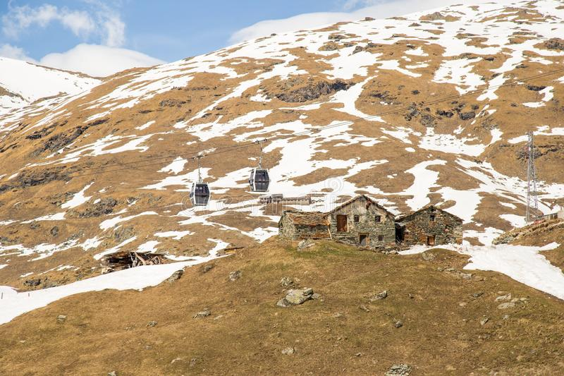 Ruined Chalets on a snow-covered scene. Gressoney, Italy stock photo