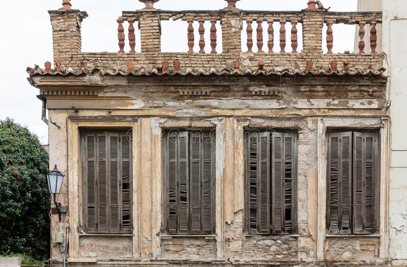 Ruined facade of an abandoned neoclassical building in old town of Plaka, Athens, Greece stock photos