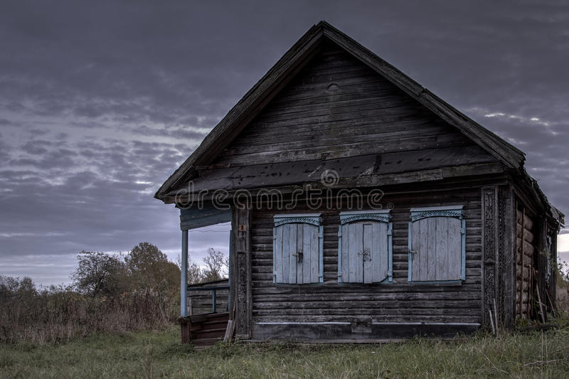 Ruined house abandoned village on the background of the rising sun.  royalty free stock images