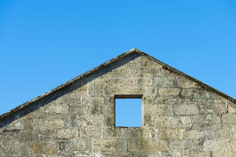 Ruined house with blue sky background royalty free stock photo