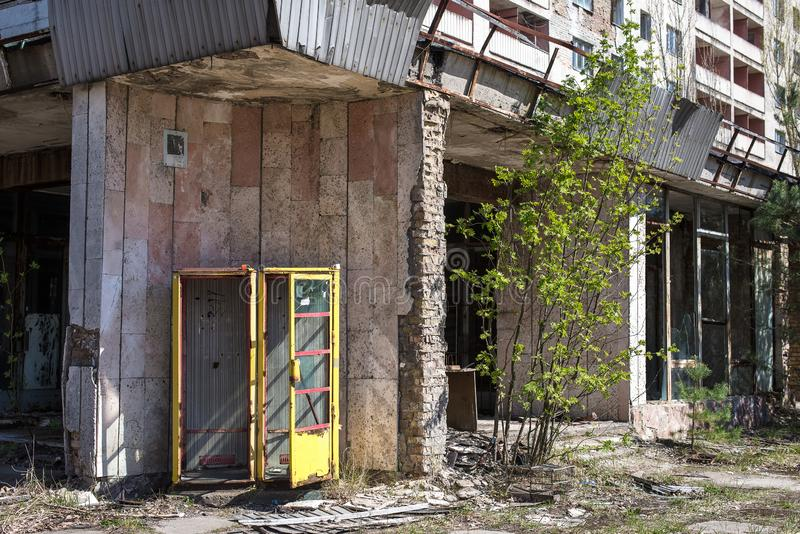 Ruined house with broken windows. The entrance, the exclusion zone, Pripyat, Chernobyl, Soviet architecture royalty free stock photo