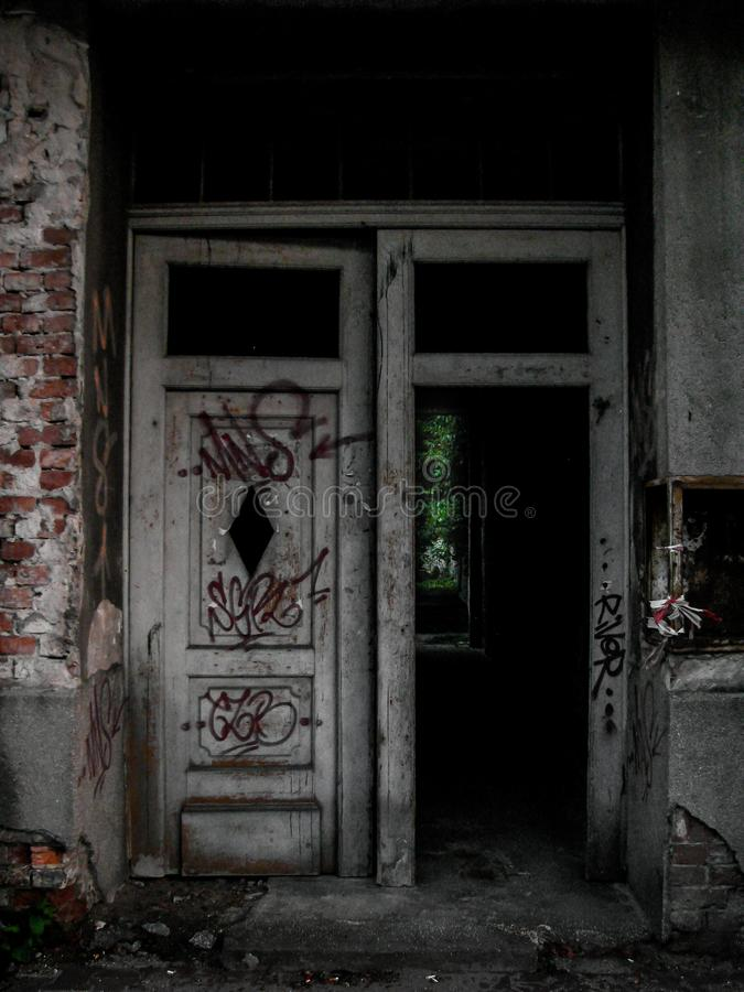 Ruined house, poverty, old doors stock image
