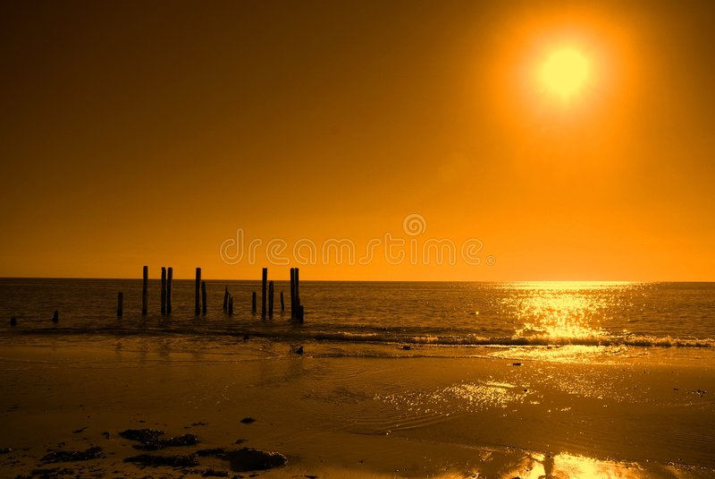 Ruined Jetty, Orange Sky royalty free stock photography
