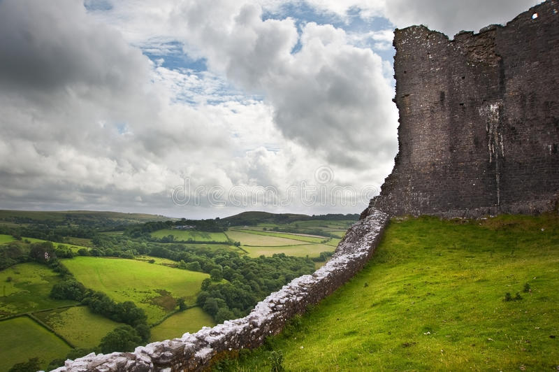 Ruined medieval castle landscape with dramatic sky stock image