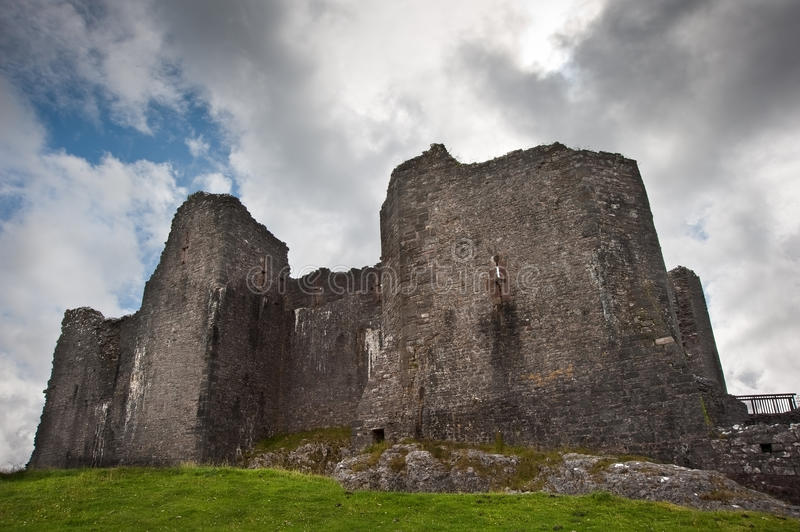 Ruined medieval castle landscape with dramatic sky royalty free stock photography