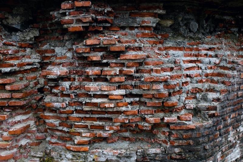 Ruined old brick red wall, Background texture. Horizontal outside shot. royalty free stock image