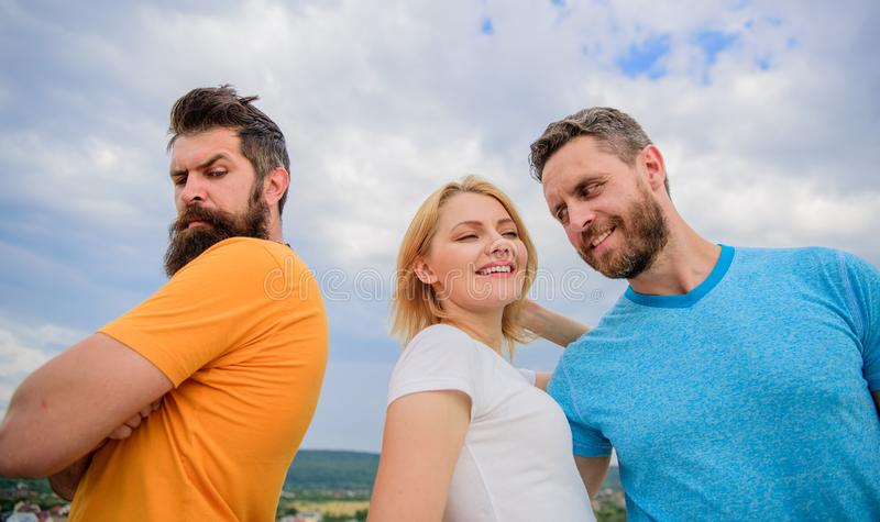 Ruined relationships. How deal with offended feelings. Girl stand between two men. Psychology of breakup. What do when. You feel rejected. Couple and rejected royalty free stock photography