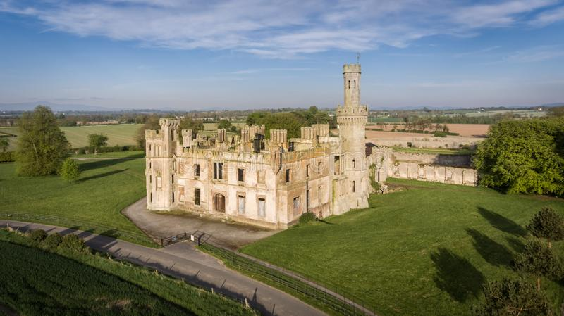Duckett`s Grove, county Carlow. Ireland. Ruined 19th century Georgian Gothic country house at sunset. county Carlow. Ireland stock photos