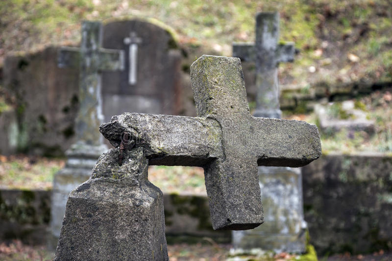 Ruined tombstone. In old weathered cemetery stock photo