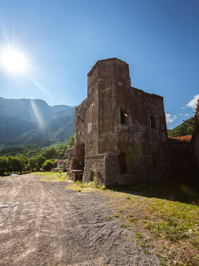 Ruined tower of castle on side of the road at sunny day royalty free stock photo