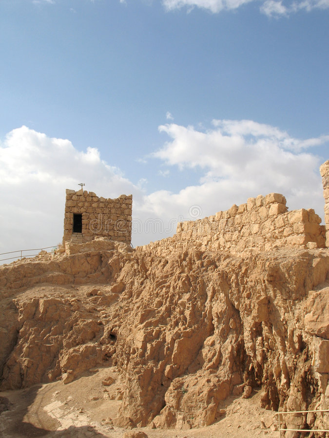 Ruined walls of Masada. Masada is the name for a site of ancient palaces and fortifications in the South District of Israel on top of an isolated rock plateau royalty free stock photography