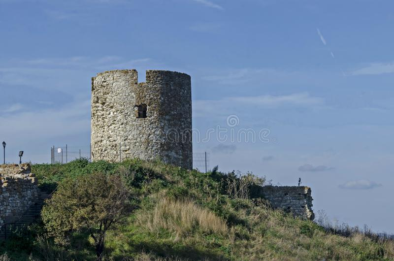 Ruined watch tower and stone with brick walls around Western fortification in ancient city Nessebar or Mesembria on the Black Sea. Coast, Bulgaria, Europe royalty free stock image
