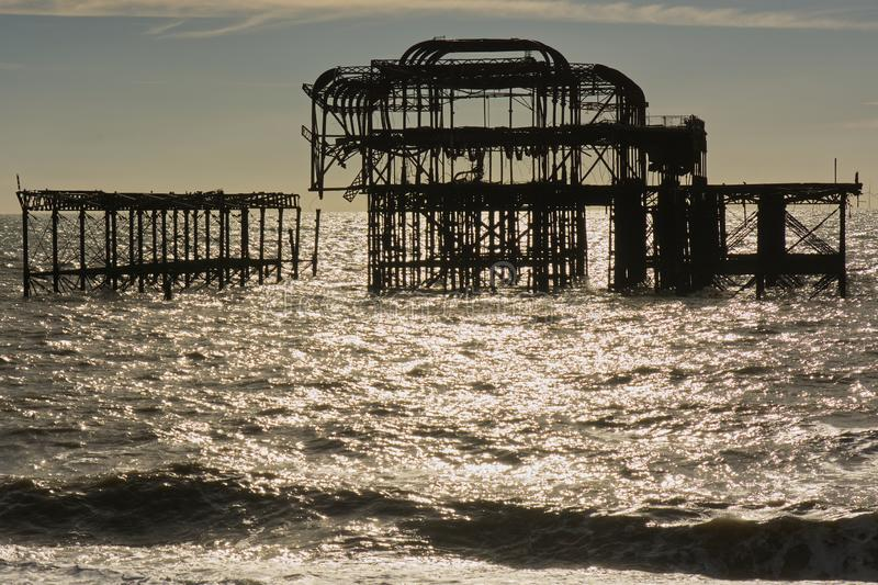 Ruined West Pier, Brighton, Sussex, England. Ruined West Pier on the seafront at Brighton, East Sussex, England royalty free stock photos