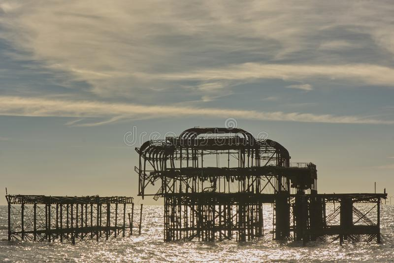 Ruined West Pier, Brighton, Sussex, England. Ruined West Pier on the seafront at Brighton, East Sussex, England royalty free stock images
