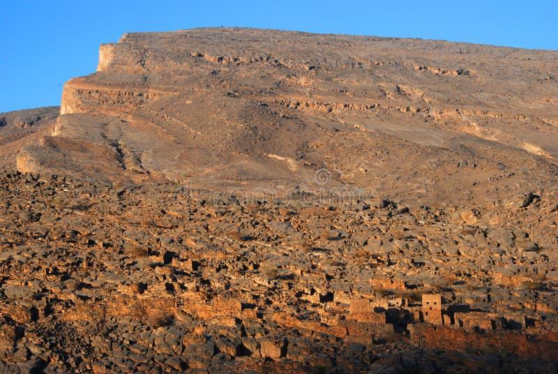 Ruines de vieux bâtiments de mudflat dans la ville Biladt Sait en Oman photo stock