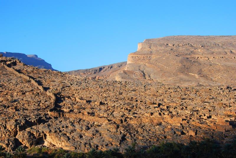 Ruines de vieux bâtiments de mudflat dans la ville Biladt Sait en Oman photographie stock libre de droits
