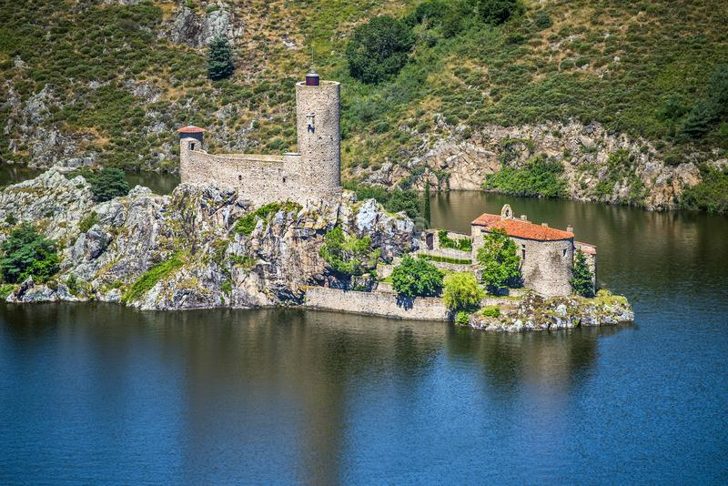 Ruines of the old castle and medieval chapel in the Grangent island. Gorges de la Loire, Saint Etienne region, France.  stock image