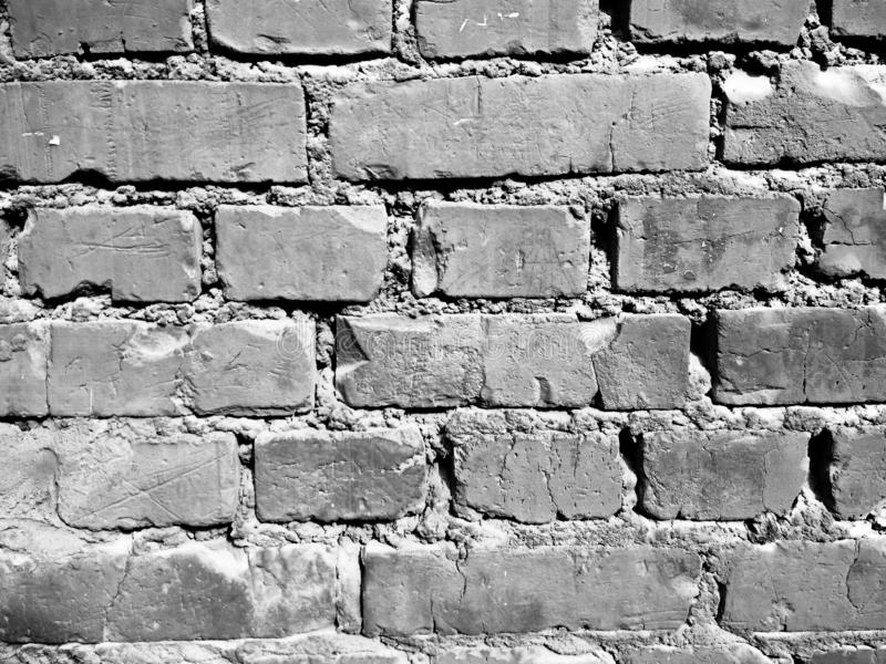 Ruinierter Backsteinmauerfotoschwarzweiss-hintergrund lizenzfreies stockfoto