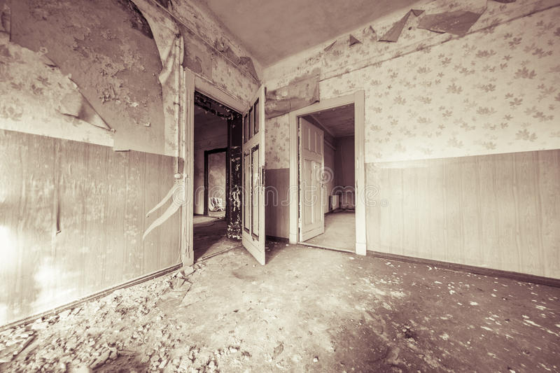Ruinous empty room with old wallpapers. And sepia color filter stock photo