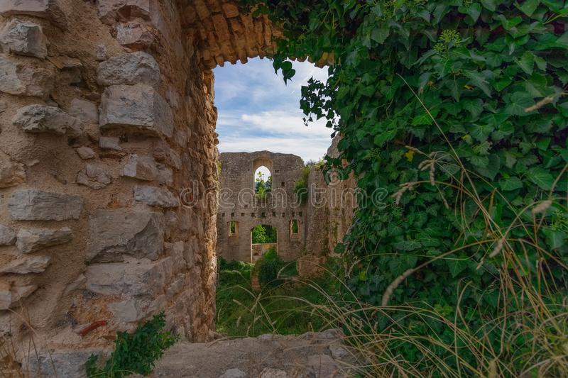 The ruins of the abandoned castle Rocca di Piediluco on the hi stock photography
