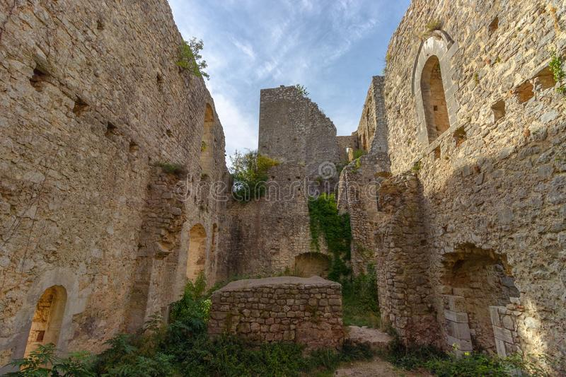The ruins of the abandoned castle Rocca di Piediluco on the hi royalty free stock image