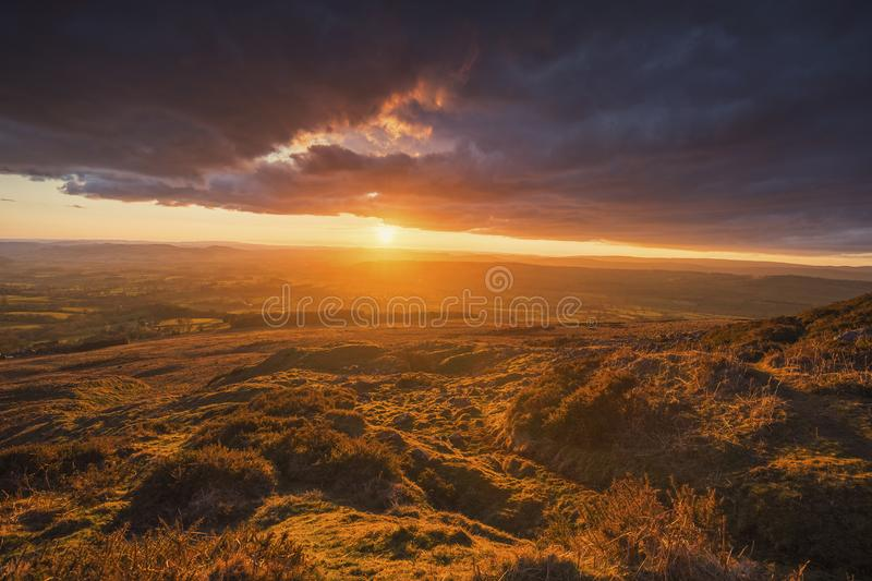 Scenic Sunset over Upland in Spring. Ruins of abandoned quarry at the top of Titterston Clee Hill in Shropshire, UK royalty free stock photography