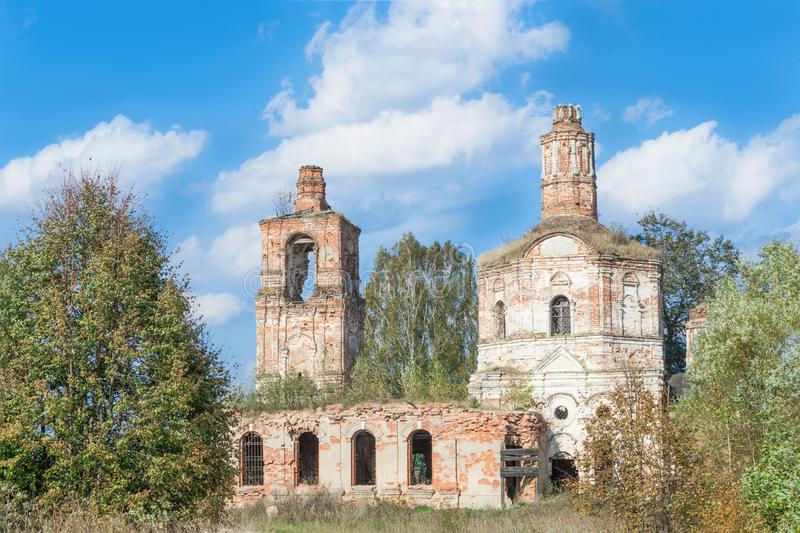 Ruins of ancient abandoned dilapidated brick Christian Church with bell tower stock image