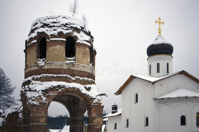 Ruins of ancient Assumption Cathedral and orthodox church. Of white stone behind stock images