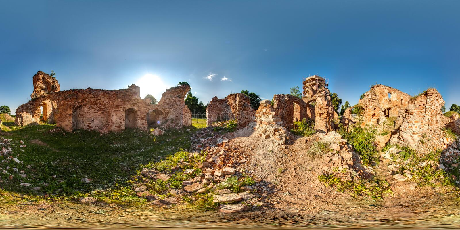 Ruins of ancient brick castle with blue sky sun green grass 3D spherical panorama with 360 degree viewing angle. Ready for virtual. Reality in vr. Beautiful royalty free stock photos