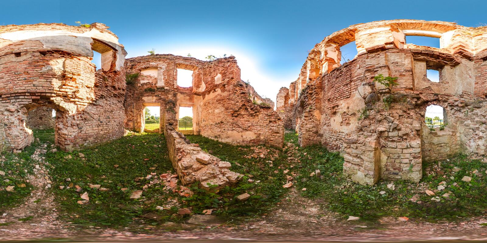 Ruins of ancient brick castle with blue sky sun green grass 3D spherical panorama with 360 degree viewing angle. Ready for virtual. Reality in vr. Beautiful stock images