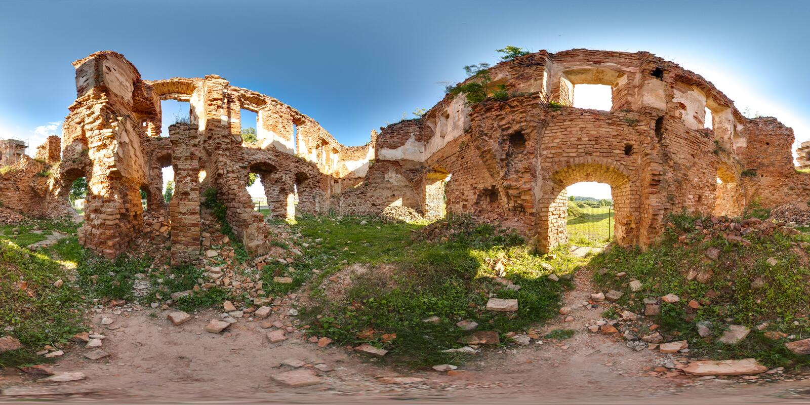 Ruins of ancient brick castle with blue sky sun green grass 3D spherical panorama with 360 degree viewing angle. Ready for virtual. Reality in vr. Beautiful stock photo