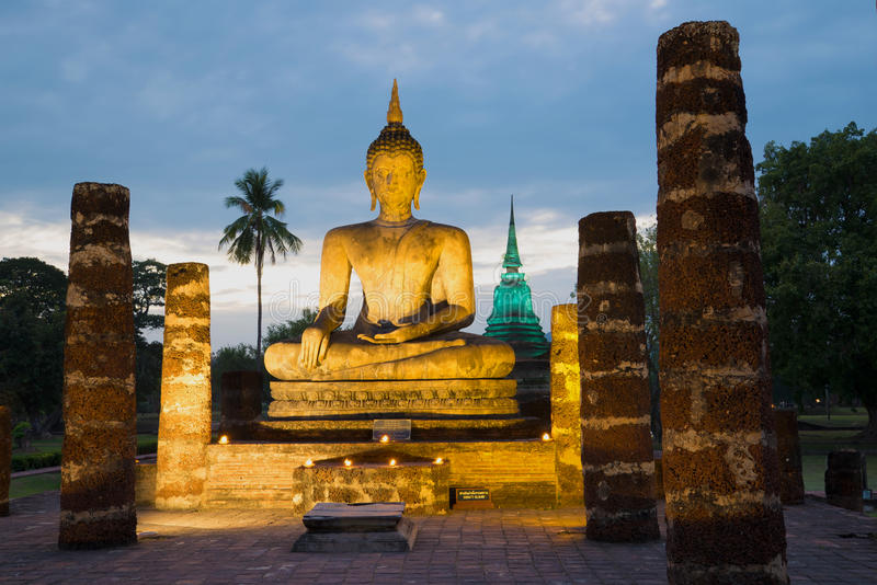 Ruins of the ancient Buddhist temple of Wat Chana Songkram. Historical park of the city of the Sukhothai, Thailand. Sculpture of the sitting Buddha in night royalty free stock photography