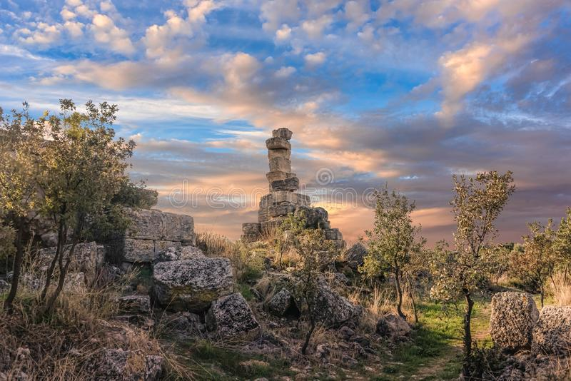 Ruins of an ancient building in a long forgotten city in northwe. Stern Turkey under blue skies with fluffy white clouds during sunset stock photo