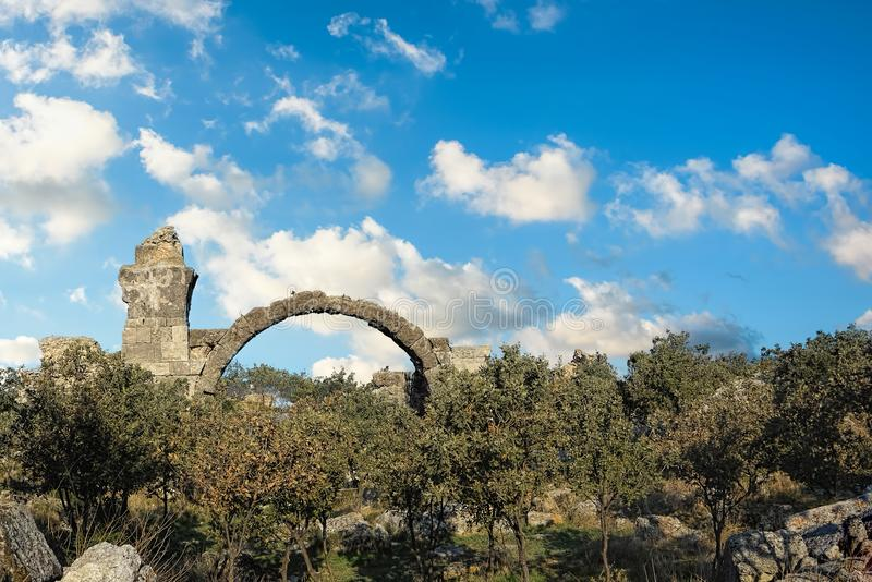 Ruins of an ancient building in a long forgotten city in northwe. Stern Turkey under blue skies with fluffy white clouds royalty free stock image