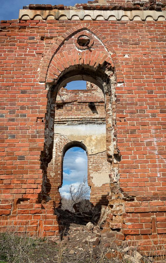 Ruins of an ancient building in Ulyanovsk, Russia. Arch and piece of red brick wall royalty free stock photos