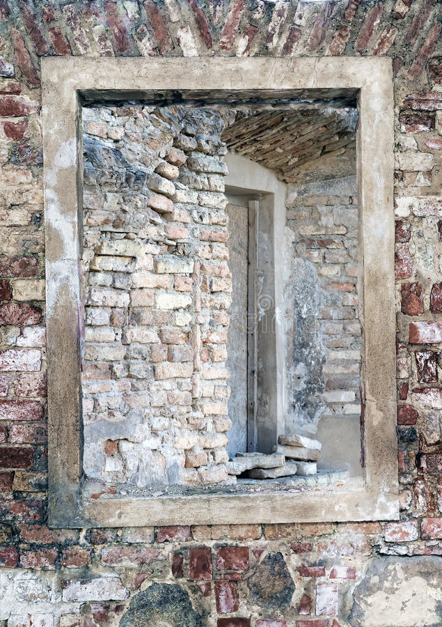 Ruins of ancient church. Visible windows through an aperture stock photo