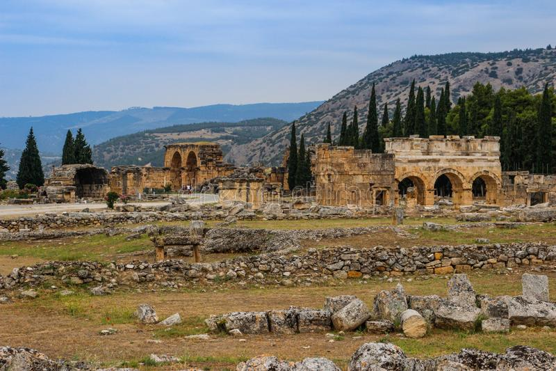 The ruins of the ancient ancient city of Hierapolis with columns, gates and graves in Pamukalle royalty free stock photos