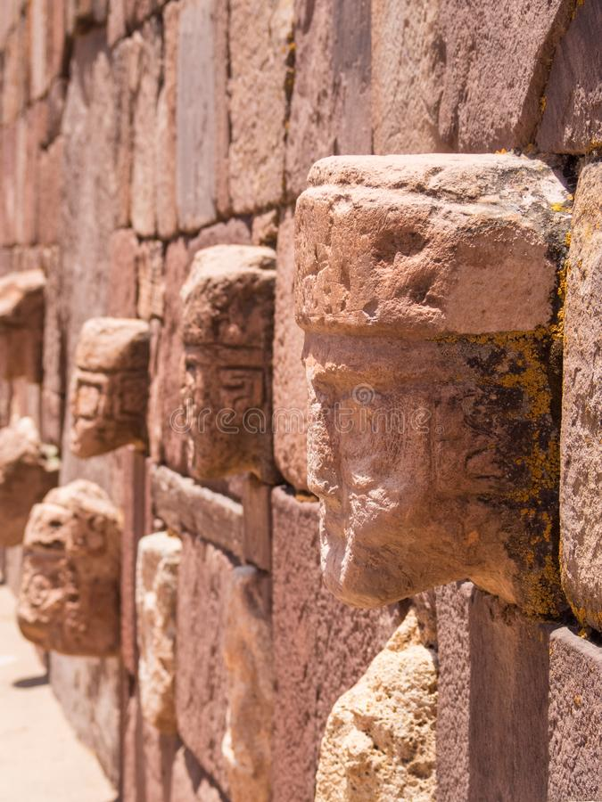 Ruins of the ancient city of Tiwanaku, Bolivia, faces view. Ancient ruins stock photo