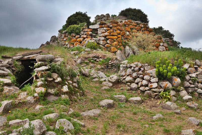 Ruins of ancient culture Sardinia Nuraghe tower stock photo