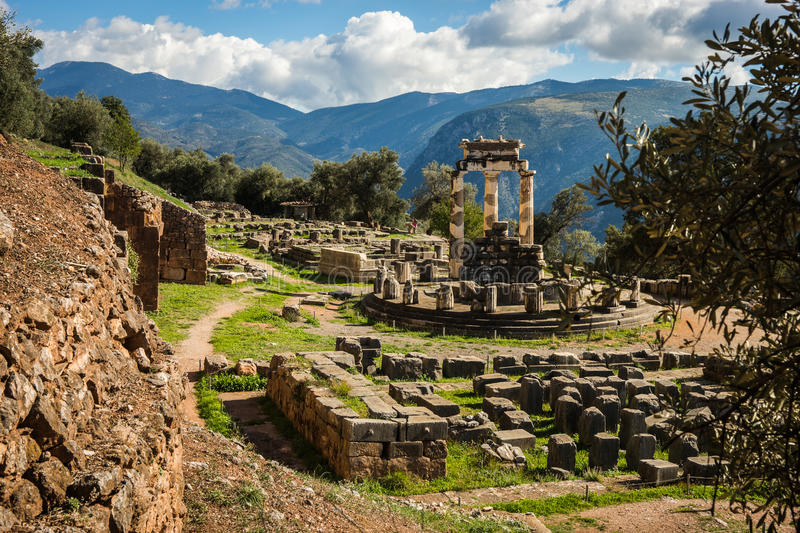 Ruins of an ancient greek temple of Apollo at Delphi, Greece royalty free stock images