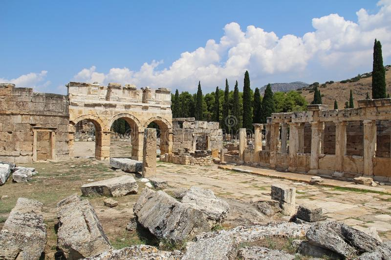 The ruins of the ancient Hierapolis city next to the travertine pools of Pamukkale, Turkey. The Frontinus street. stock photos