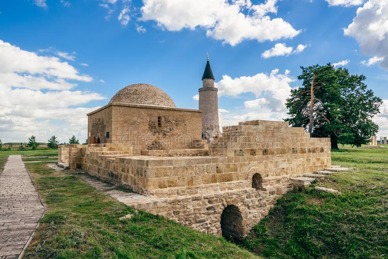 Ruins of Ancient Khan& x27;s Tomb. Ruins of Ancient Khan& x27;s Tomb in Bolghar Hill Fort and Small Minaret on Backdrop royalty free stock photo