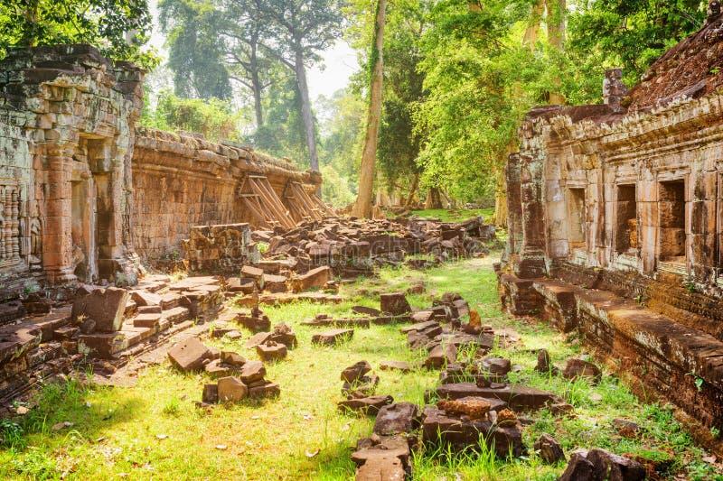 Ruins of ancient Preah Khan temple in Angkor in morning sun. Mysterious ruins of ancient Preah Khan temple in amazing Angkor in morning sun. Siem Reap, Cambodia stock images