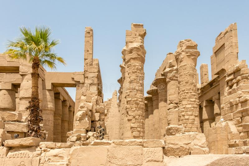The ruins of an ancient temple in Egypt, Karnak, Luxor. The Temple of Amun is the largest religious building in the world and honors not only Amun but other gods royalty free stock photos
