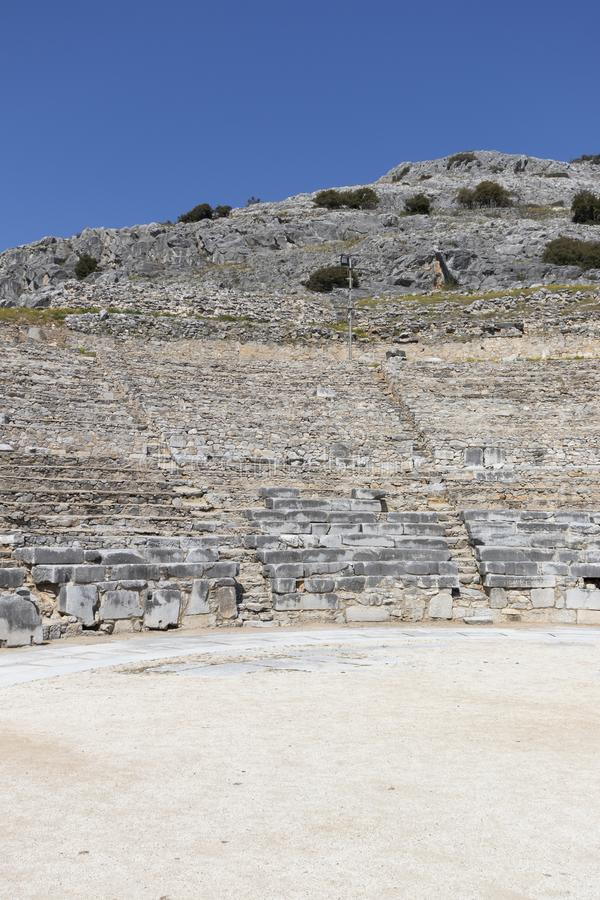 Ruins of The ancient theatre in the Antique area of Philippi, Eastern Macedonia and Thrace, Greece. View of ruins of The ancient theatre in the Antique area of stock image