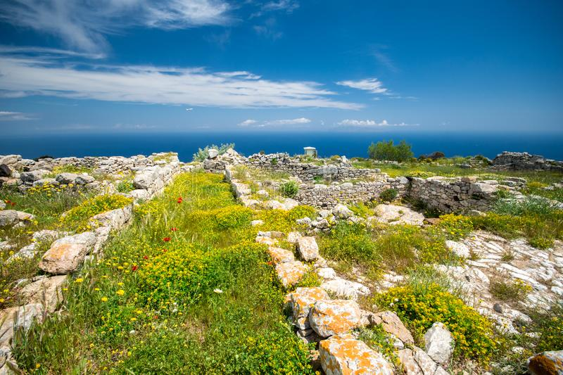 The ruins of ancient Thira, a prehistoric village at the top of the mountain Mesa Vouno, Santorini. Greece stock photography