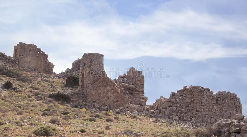 Ruins of ancient Venetian windmills built in 15th century, Lassithi Plateau, Crete, Greece royalty free stock photos