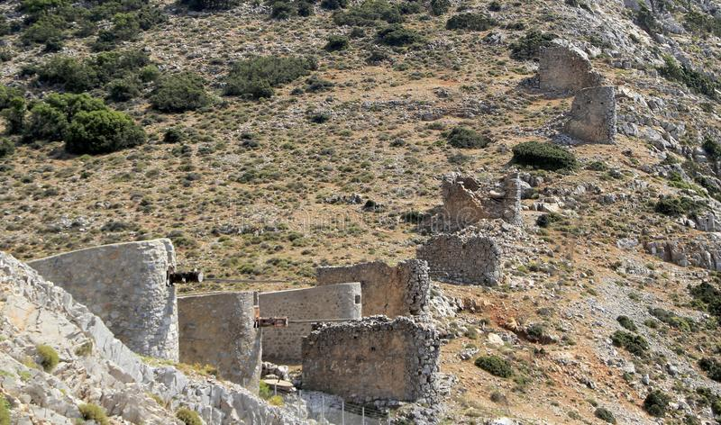 Ruins of ancient Venetian windmills built in 15th century, Lassithi Plateau, Crete, Greece royalty free stock photo